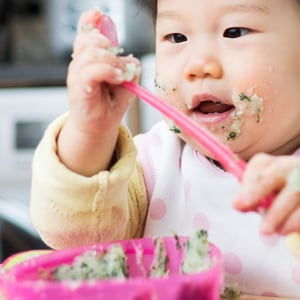 Baby eating vegetables